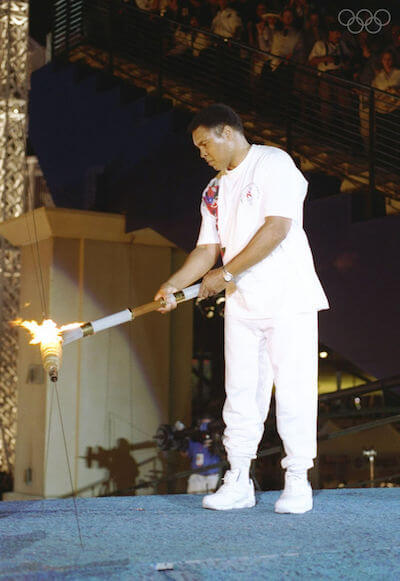 https://www.olympic.org/photos/19-jul-1996-muhammad-ali-holds-the-torch-before-lighting-the-olympic-flame-during-the-opening-cere